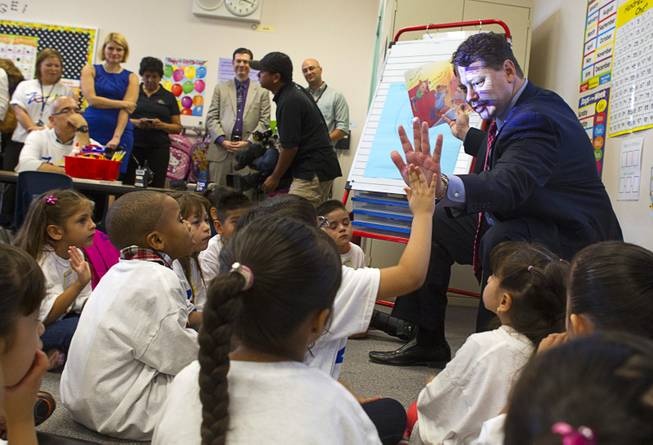 "Clark County School District Superintendent Pat Skorkowsky gets a high five while reading to kindergarten students during the first day of school at Cambeiro Elementary School Monday, Aug. 26, 2013. The school is a ""Zoom"" school, one of 14 CCSD schools that will receive additional state money and resources to help students who don't speak English."