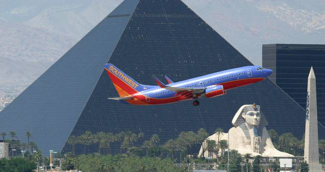 A Southwest Airlines flight approaches McCarran International Airport with the Luxor in the background.