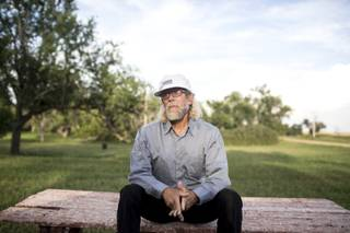 Paul Craig Cobb on a picnic table across from his house in Leith, N.D., Aug. 26, 2013. Cobb, a newcomer to Leith, which has a population of about 20 people, has been buying up property in an attempt to transform the town into a colony for white supremacists.