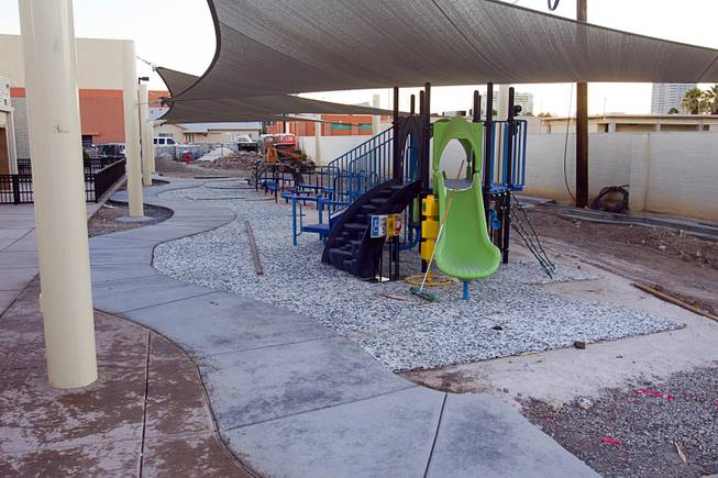 A playground, still under construction, for preschool and kindergartens students is shown during a grand opening ceremony for the 9th Bridge School in downtown Las Vegas Tuesday, Aug. 27, 2013. The private school/early childhood learning center, part of the Downtown Project, opened August 26 with infants through kindergarten students and will gradually add grades.