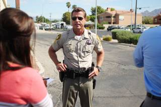 Metro Sgt. John Sheahan briefs members of the media about a hostage situation near Mountain Vista Street and Tropicana Avenue Tuesday, August 27, 2013. A woman is believed to be barricaded inside a home, possibly with two children and several weapons.