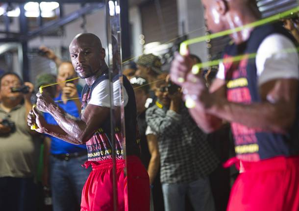 Undefeated boxer Floyd Mayweather Jr. watches his reflection in a mirror as he works out at the Mayweather Boxing Club Wednesday, August 28, 2013. Mayweather will face Canelo Alvarez of Mexico in a WBC/WBA 154-pound title fight at the MGM Grand Garden Arena on September 14.