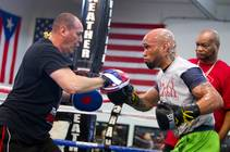 IBF 154-pound champion Ishe Smith, right, works on his timing with assistant trainer Rafael Ramos at the Mayweather Boxing Club Wednesday, August 28, 2013. Head ...