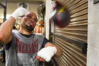 IBF 154-pound champion Ishe Smith hits a speedbag at the Mayweather Boxing Club on Wednesday, Aug. 28, 2013. Smith will defend his title against Carlos Molina of Mexico on Sept. 14 at the MGM Grand Garden Arena.
