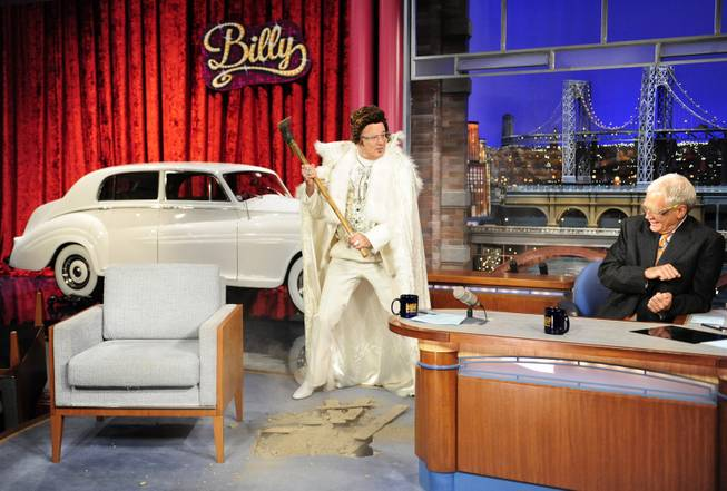 In this Aug. 29, 2013 photo provided by CBS, actor Bill Murray, left, joins host David Letterman on the set of the Late Show with David Letterman, in New York, as the show celebrates its 20th Anniversary on Thursday, Aug. 39.  Murray was the Late Show's first guest 20 years ago and retrieved a time capsule as part of the festivities. The show airs Thursday, Aug. 29.