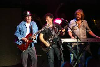 Carlos Santana and Gregg Rolie join Neal Schon onstage during Journey's concert at Pearl at the Palms on Wednesday, Aug. 28, 2013.