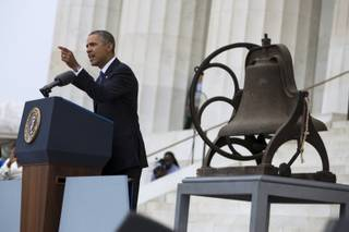 President Barack Obama gestures while speaking at a ceremony commemorating the 50th anniversary of the March on Washington, Wednesday, Aug. 28,2013, at the Lincoln Memorial in Washington.