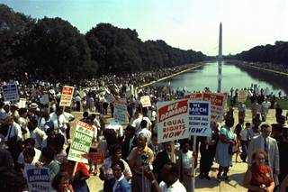 People carry civil rights signs as they gather in Washington, D.C. before Martin Luther King Jr.'s
