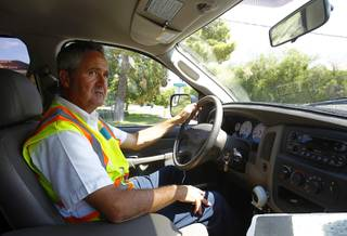 Robert Kern, a meter services field representative for the Southern Nevada Water Authority (SNWA), looks for water waste as he drives through a neighborhood near Rancho Dr. and Oakey Blvd. Thursday, August 29, 2013.