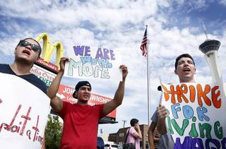 Mcdonald's employees Salavador Hernandez, from left, Jorge Martinez and Socrates Garcia protest for higher wages in front of a McDonald's on the corner of Paradise Road and Sahara Avenue in Las Vegas on Thursday, August 29, 2013.