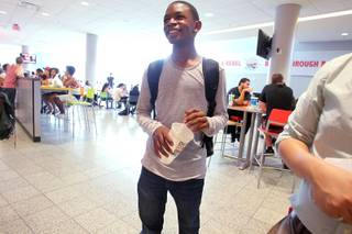 Ke'Andre Blackston Jr., a 14-year-old freshman at UNLV, waits for a lunch order in the student union.
