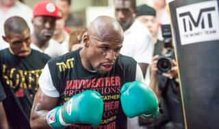 Undefeated boxer Floyd Mayweather Jr. hosts a workout for media at Mayweather Boxing Club in Las Vegas on Wednesday, Aug. 28, 2013.