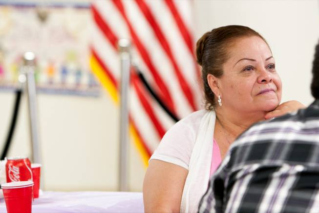 Maria Montalvo listens to speakers during a celebratory meeting focused on the one-year anniversary of deferred action for childhood arrivals at the Progressive Leadership Alliance of Nevada headquarters in Las Vegas Thursday evening, August 15, 2013.