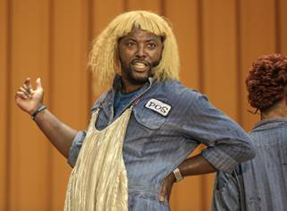 In this Aug. 27, 2013, photo, rapper Postell Pringle wears a wig as he performs in a hip hop adaptation of William Shakespeare's Othello, titled