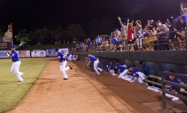 Fans cheer as the 51s players run out of the dugout after winning the Pacific Coast League Southern Division title beating Tuscan 8-6, Saturday, Aug. 31, 2013.