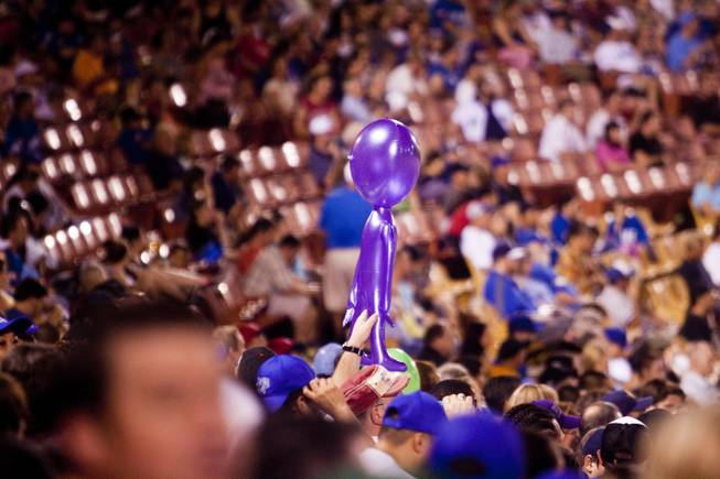 A fan holds up an inflated purple alien during the 51s game against Tuscon, Saturday, Aug. 31, 2013. The 51s won the Pacific Coast League Southern Division title beating Tuscan 8-6.