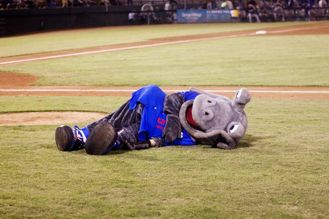 The 51s Alien mascot lies on the ground during their game against Tuscon, Saturday, Aug. 31, 2013. The 51s won the Pacific Coast League Southern Division title beating Tuscan 8-6.