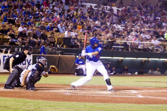 Francisco Pena homers for the Las Vegas 51s against Tucson, Saturday, Aug. 31, 2013. The 51s beat Tucson Padres, 8-6, and clinched the Pacific Coast League Southern Division title.