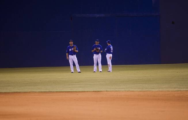 51s outfielders from left, Jamie Hoffman, Kirk Nieuwenhuis and Mike Baxter talk during a time out at the beginning of the sixth inning. The 51s went on to win the Pacific Coast League Southern Division title beating Tuscan 8-6, Saturday, Aug. 31, 2013.