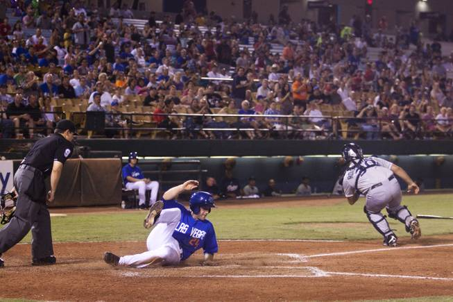 The Las Vegas 51s Eric Campbell slides into home  in the fifth inning during their game against Tucson, Saturday, Aug. 31, 2013. The 51s beat Tucson 8-6 to win the Pacific Coast League Southern Division title.