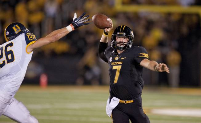 Missouri quarterback Maty Mauk, right, throws the ball past Murray State's Demetric Johnson during the fourth quarter of an NCAA college football game Saturday, Aug. 31, 2013, in Columbia, Mo. Missouri won the game 58-14.