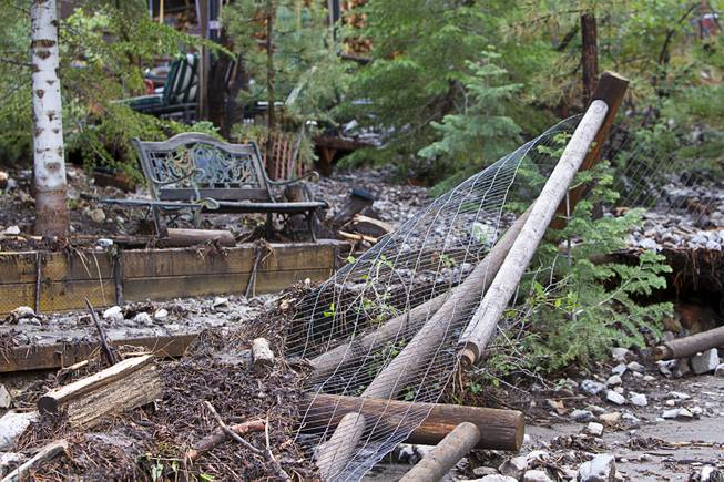 A damaged garden area is shown by a home in the Rainbow Canyon subdivision on Mount Charleston Sunday, Sept. 1, 2013.
