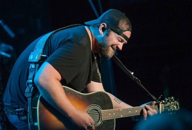 Opening act Lee Brice performs during headliner Brad Paisley's Beat This Summer Tour stop at Mandalay Bay Events Center on Saturday, Aug. 31, 2013.