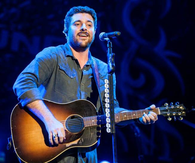 Opening act Chris Young performs during headliner Brad Paisley's Beat This Summer Tour stop at Mandalay Bay Events Center on Saturday, Aug. 31, 2013.