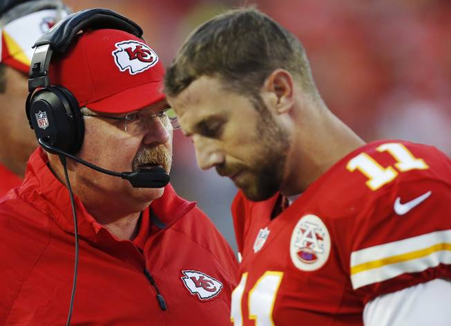 Kansas City Chiefs coach Andy Reid, left, talks with quarterback Alex Smith during the first half of an preseason NFL football game against the San Francisco 49ers at Arrowhead Stadium in Kansas City, Mo., Friday, Aug. 16, 2013.