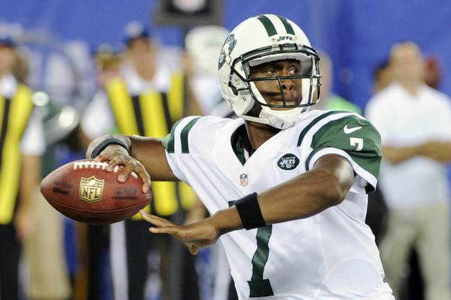 New York Jets quarterback Geno Smith looks for a receiver during the second half of a preseason NFL football game against the New York Giants Saturday, Aug. 24, 2013, in East Rutherford N.J.