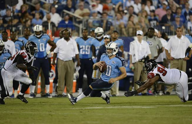 Tennessee Titans quarterback Jake Locker (10) falls to the turf after running against the Atlanta Falcons during the first half of an NFL preseason football game, Saturday, Aug. 24, 2013, in Nashville, Tenn.