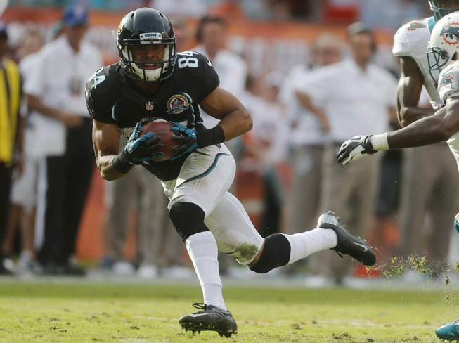 Jacksonville Jaguars wide receiver Cecil Shorts (84) runs with the ball during the second half of an NFL football game against the Miami Dolphins, Sunday, Dec. 16, 2012, in Miami.