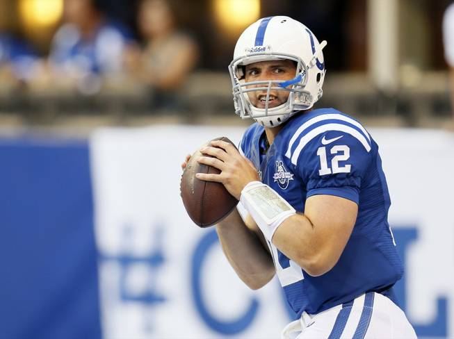 Indianapolis Colts quarterback Andrew Luck throws before a preseason NFL football game against the Cleveland Browns in Indianapolis, Saturday, Aug. 24, 2013.