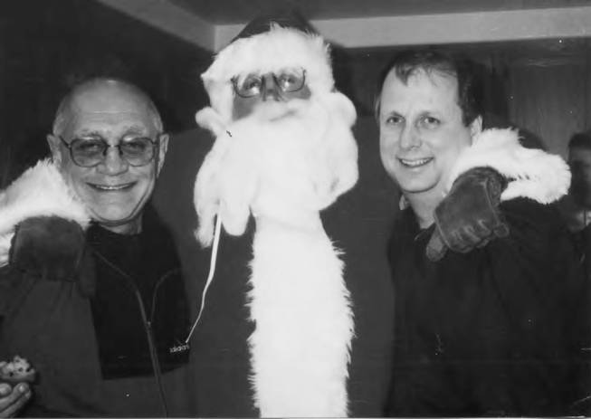 In this undated photo Former UNLV basketball coach Jerry Tarkanian (left) poses with assistant coaches Mark Warkentien (right) and Tim Grgurich (Santa).