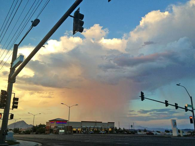 A thunderhead unleashed a shower in the east side of the Las Vegas Valley, as shown looking northeast from the intersection of Stephanie Road and American Pacific Drive in Henderson Thursday evening, Sept. 5, 2013.