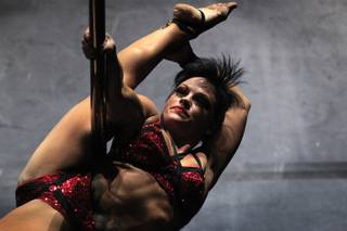 Amber Cahill performs during the Pole Classic at Rain Nightclub inside the Palms in Las Vegas on Friday, September 6, 2013.