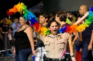 Participants march in the 15th annual PRIDE night parade in downtown Las Vegas, Friday, Sept. 6, 2013.