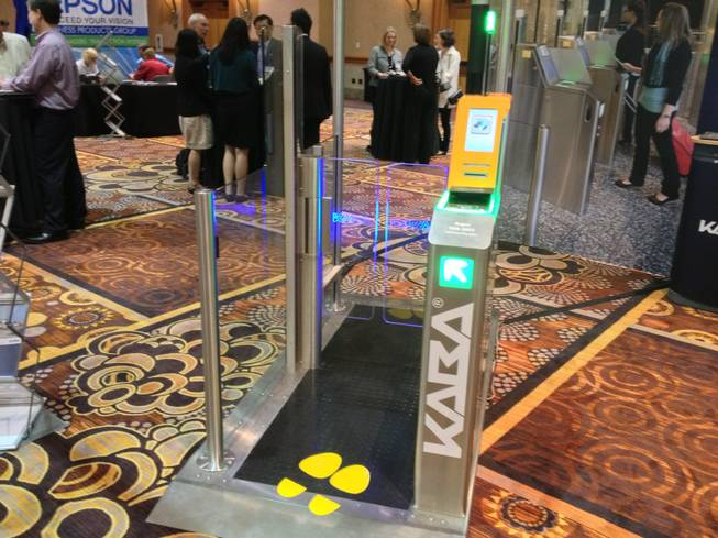 Kaba, an access and data systems technology company based in Ben Wheeler, Texas, showed its multipurpose check-in gateway that automates the aircraft boarding process, shown at the Future Travel Experience Global trade show on Sept. 5, 2013.