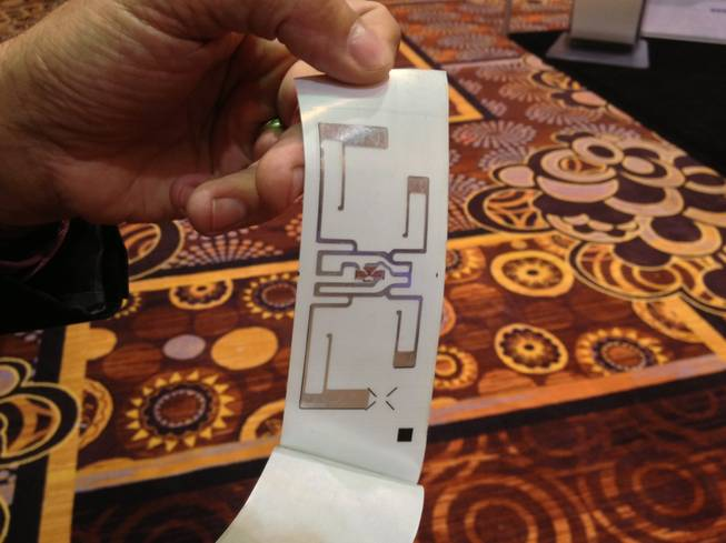 Bag tags issued at McCarran International Airport have radio frequency identification devices embedded in the tag to easily locate and identify a bag, shown at the Future Travel Experience Global trade show on Sept. 5, 2013.