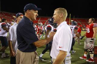 UNLV head coach Bobby Hauck, right, congratulates University of Arizona head coach Rich Rodriguez after UNLV's home opener against Arizona at Sam Boyd Stadium on Saturday, Sept. 7, 2013.