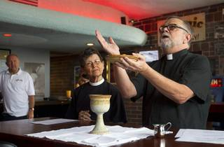 Deacon Bonnie Polley, left, and Episcopal priest Buck Belmore  conduct an inaugural pub church service at the Atomic, 917 East Fremont Street, in downtown Las Vegas Sunday, Sept. 8, 2013.