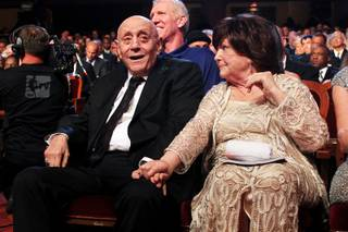 Lois Tarkanian holds her husband Jerry Tarkanian's hand after he was inducted into the Naismith Memorial Basketball Hall of Fame Sunday, Sept. 8, 2013 in Springfield, Mass.