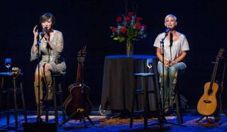 Lorrie Morgan (short blonde hair) and Pam Tillis (light-brown hair) at Reynolds Hall in Smith Center for the Performing Arts on Saturday, Sept. 7, 2013, for their