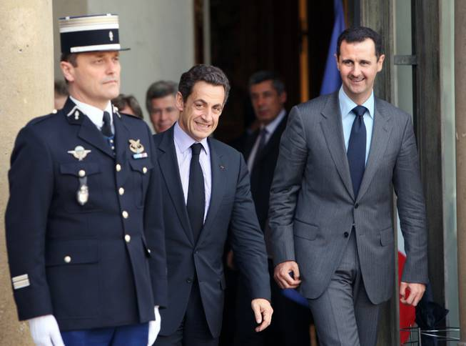 In this Friday, Nov. 13, 2009 file photo, French President Nicolas Sarkozy, second left, escorts Syrian President Bashar Assad, right, following their meeting at the Elysee Palace in Paris.