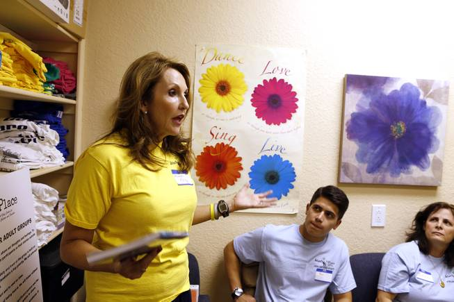 Kelly Thomas-Boyers, the founder of and President of Adam's Place for Grief, leads a briefing for volunteers before group sessions in Las Vegas on Tuesday, September 10, 2013.