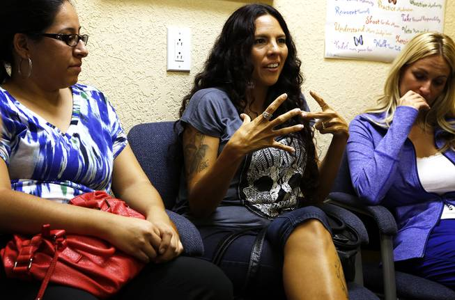 Josephine Napolitano, center, shares her story during adult group session at Adam's Place for Grief in Las Vegas on Tuesday, September 10, 2013.