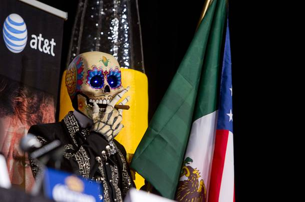 A day of the Dead character waits for the start of a news conference featuring Floyd Mayweather Jr. and Canelo Alvarez of Mexico at the MGM Grand Wednesday, Sept. 11, 2013. Mayweather and Alvarez will meet for a WBC/WBA 154-pound title fight at the MGM Grand Garden Arena on Saturday.