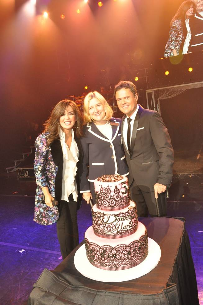 Marie Osmond, Flamingo Las Vegas Regional President Eileen Moore and Donny Osmond onstage in the Flamingo Showroom on Tuesday, Sept. 10, 2013, to celebrate the brother and sister's resident headliner show's fifth anniversary.