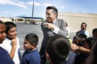 Governor Brian Sandoval talks to a fifth grade class while touring Manuel Cortez Elementary School in Las Vegas on Friday, September 13, 2013.
