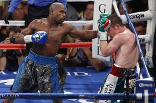 Super welterweight champion Floyd Mayweather hits Saul